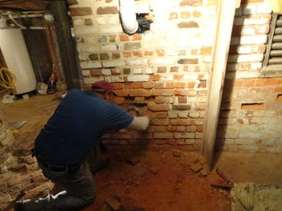Sensitive masonry repair and restoration work on interior brick walls